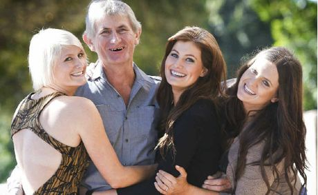 Peter McClymont gets a hug from his daughters (l-r) Mollie, Sam and Brooke McClymont prior to a Mayoral Reception yesterday.