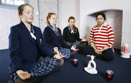 Sarojini Kandula, of My Health Yoga Meditation, coaches Ipswich Girls' Grammar School students (from left) Sophie McCleary, Brittany Blacka, and Rachel Tom in overcoming their stresses.