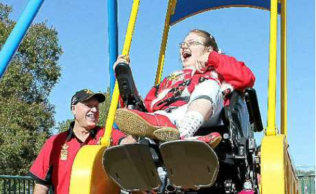 FLYING HIGH: Bruce Taylor from Variety NSW helps Naikia Taylor have fun on the new Liberty swing in Nesbitt Park.
