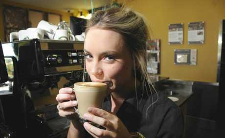 Zarraffa's Coffee store manager Taylor Doyle enjoys a coffee this morning.