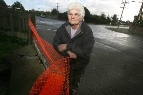 DANGEROUS: Masterton resident Claire Apiata on the dangerous intersection on Colombo Rd and Kuripuni St, Masterton. She is standing where a car drove through her property.
