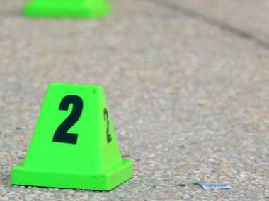 Evidence markers on road at the crime scene in Robina killing. Photo: John Gass / Tweed Daily News TWE170511crime