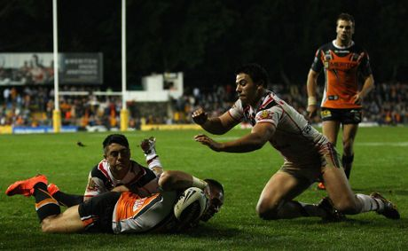 Matt Utai of the Tigers scores a try during the round 11 NRL match between the Wests Tigers and the Warriors at Leichhardt Oval 