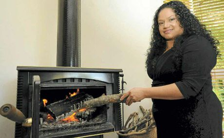 Pascale Rose, of Clunes, prefers wood heating for her home to electric bar heaters.