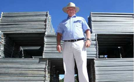 Beef Australia chairman Geoff Murphy with some of the 30,000 fence panels used at Beef Australia 2012.