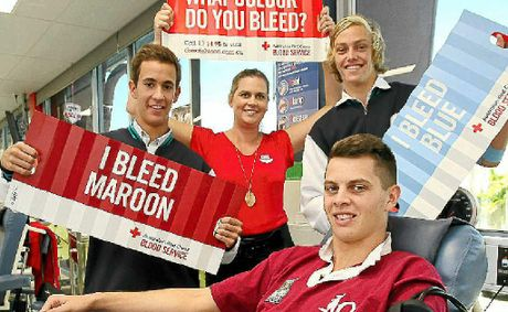 Chancellor State College student Jonty Perkins gives blood while fellow students Luke Gormley and Beau Emerson with Red Cross community relations officer Chole Cutler look on.