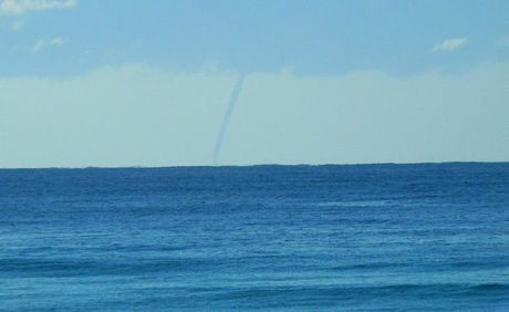 A waterspout sighted off Lennox Head today triggered tornado memories for locals.