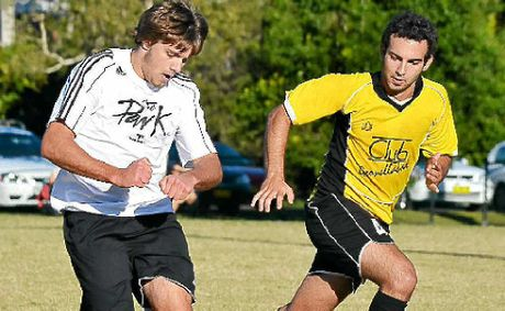 ON-FIELD: Byron Bay's Layton Barton was the team's goalie in 2011 but shows his versatility by being equally competent running the ball. Here he duels with the Hornets' Daniel Bonesi.