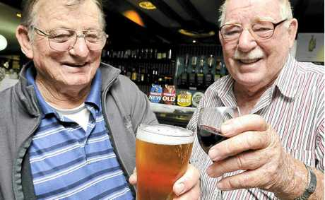 Devout beer drinker Rusty Britt, of Lismore, left, and wine drinker Bill Dempsey, of Tweed Heads, debate the merits of their chosen drops.