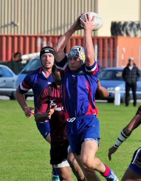 HOLDING ON: Chris Creek of Bush Sports reaches to take a pass during a club match in Carterton.