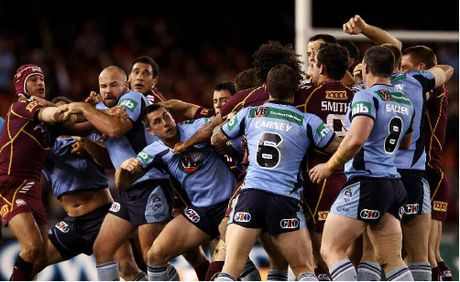 Blues and Maroons players fight during game one of the State of Origin series at Etihad Stadium in Melbourne last night.