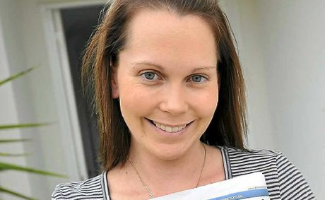 Natasha Askin accepts her boyfriend Chris Griffin's proposal which he put in the Rockhampton Morning Bulletin.