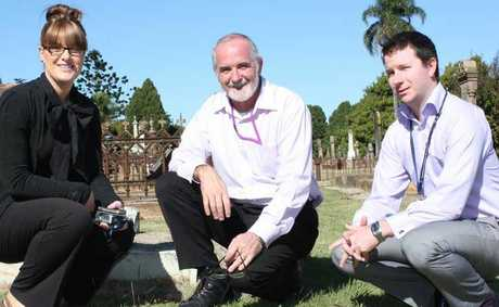 Toowoomba Probation and Parole district manager, Selina Shea, talks with Toowoomba Regional Council's regional cemetery co-ordinator Lawson Rennie and probation and parole supervisor James Male about their program at Drayton and Toowoomba Cemetery.