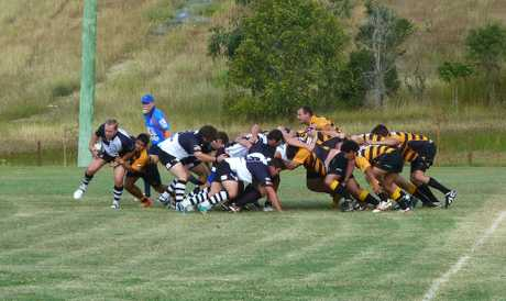 Justin Pokarier attempts to breakaway from the scrum during Biloela's clash with Capricorn Coast.