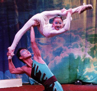 Fei Fei, 10, performs an acrobatic act with the help of Hui Hu.