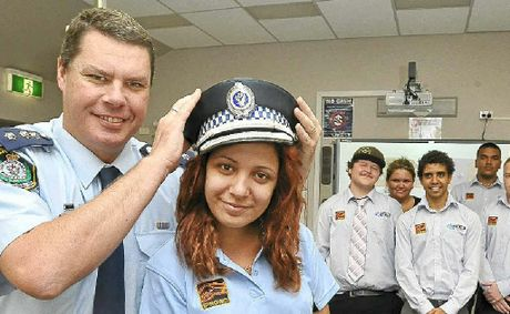 Jodie Manton of Goonellabah, 20, tries out Inspector Mick Dempsey's police hat during an IPROWD training course at the Casino TAFE. The other trainees are (from left) Matt McGann from Batemans Bay, Louise Manton of Goonellabah, Lester Moran of Ballina and Mitchell Cooper from Kempsey. The course is run by NSW Police, TAFE, and the Federal Government.