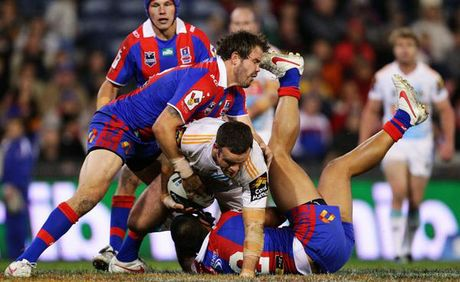 Nate Myles of the Titans is tackled during the round 12 NRL match between the Newcastle Knights and the Gold Coast Titans at Hunter Stadium.