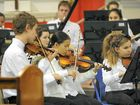 Johan Kuyler, Juliann Chuey and Joan Sutton performing in the No 2 Bundaberg Youth Orchestra at the Holy Rosary Church.
