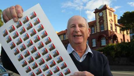 Dave Wreaks of the Tauranga Stamp Club holds a sheets of stamps that reflect the city's colourful past.