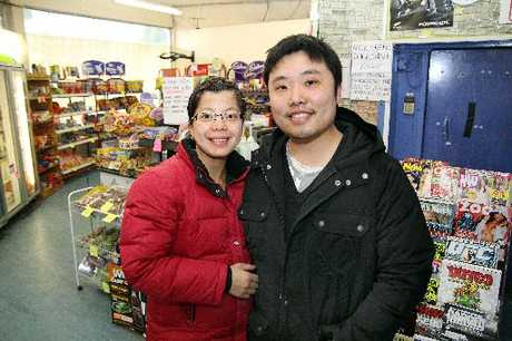 Gayhurst Mart owners Queenie Chen, left, with her husband Kay Xuan, who is recovering after being stabbed in an attack outside the dairy
