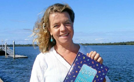 ENVIRONMENTAL MESSAGE: Ballina author/illustrator Kim Michelle Toft with her latest book which deals with climate change.