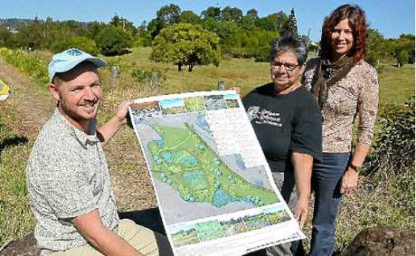 Showing off plans for a constructed wetland at Slaters Creek in North Lismore are (l-r) Lismore City Council's Environmental Strategies Coordinator Nick Stephens, Aunty Thelma James and Council's Catchment Management Officer Vanessa Tallon.