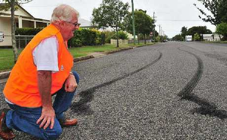 RAAG co-ordinator Graeme Ransley shows rubber left on Field St, West Mackay after a hoon performed a burnout and ended up crashing into a tree. Mr Ransley said he laughed at the silly actions of the hoon but was pleased no one was injured.