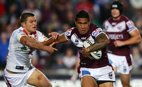 Jorge Taufua of the Sea Eagles fends during the round 13 NRL match between the Manly Warringah Sea Eagles and the St George Illawarra Dragons at Brookvale Oval