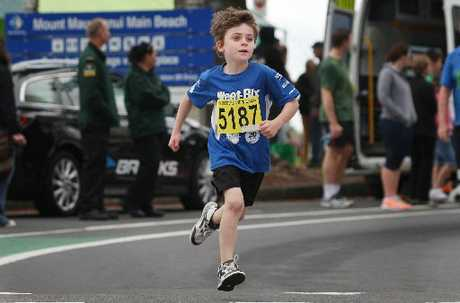 SMALL IN STATURE, BIG IN SPIRIT: Sean Curragh, 7, competes in the 5km race of the Mount Joggers and Walkers Half Marathon yesterday.