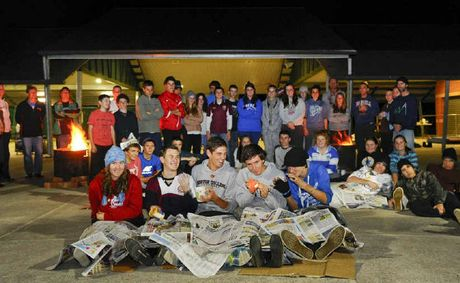 McAuley Catholic College students Katharine Crompton, Matt Haines, Jack Morrissey, James Filewood and William Summerell at the MCC sleepout to raise awareness of homelessness. Photo: JoJo Newby