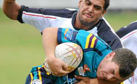 CHOP DOWN: Lower Clarence defender Grant Brown hits his Evans Head opponent with a strong tackle. Photo: Adam Hourigan
