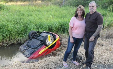 Helen and Mark Warwick saved an 18-year-old female driver from drowning after they stopped to check on her upturned vehicle on Bauple-Woolooga Rd on Saturday. Despite upturned cars being a regular sight in the area, Helen noticed a tail-light and urged her husband to stop.