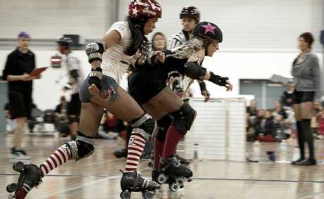 Monie Bones from Tweed Valley Rollers tries to take out Northern Rivers Roller Derby jammer, Dreaded Cat.