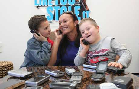 Jenny Butler, pictured with her son Gabriel Butler (left) and Ryan Koppen is collecting old mobile phones. For every 250 phones she collects, the Memogroup will donate an i Pad to the Caboolture Special School. Photo Darryn Smith / Caboolture News