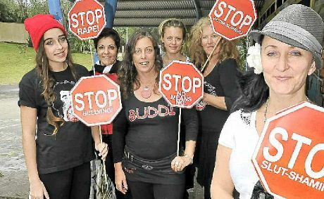 POWERFUL MESSAGE: Nicolle Gill (front) with (back from left) Lily Smith, Trish Passaniti, Nicqui Yazdi, Kate Reed and Lisa Apostolides, prepare for the SlutWalk in Byron Bay on June 23.
