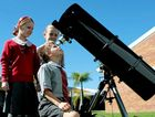 FRONT-ROW SEATS: Whitsunday Anglican School Year 6S students (from left) Portia Allison, Max Pappin and Dayna Bushell prepare their telescope ahead of today's passing of Venus between the earth and the sun for the last time until 2117.