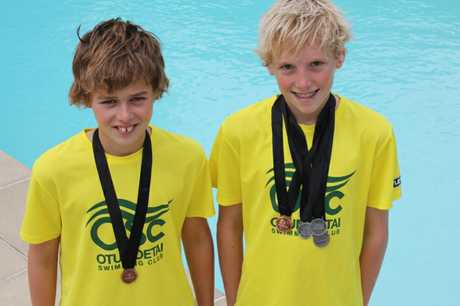 Otumoetai Swimming Club juniors Thomas Chaney, left, and George Williams show off their medal haul from this year's national junior championships.