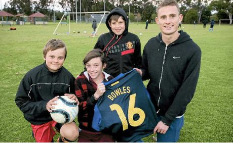 Daniel Bowles (right) talks with St Albans under-12 players Zac Erlandson, Lockie Wilson and Cody Walker at training.