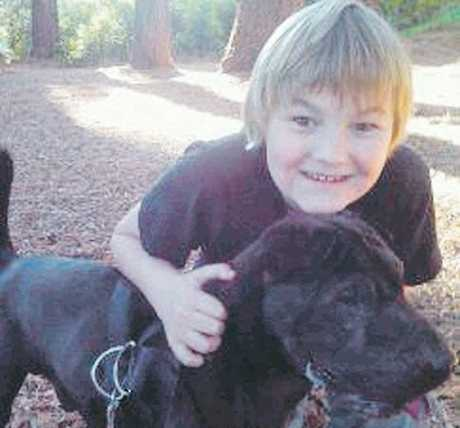 LOST FRIEND: Jakkob Hannay with Paua the sharpei which died from an infection after he was mauled by two pitbulls on the green belt in Maraenui, Napier.PHOTO/SUPPLIED
