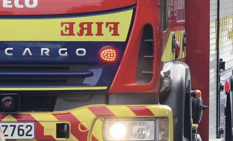 A man had a lucky escape after a damaged extension lead sparked a fire which gutted an Addington flat kitchen