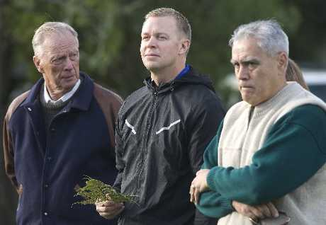 COACH: American football college coach Bronco Mendenhall (middle) is welcomed on to Apumoana Marae.