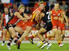 Josh Caddy of the Suns collides with Ahmed Saad of the Saints during the round 11 AFL match between the Gold Coast Suns and the St Kilda Saints at Metricon Stadium