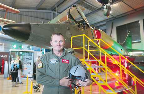 FIGHTER PILOT: Former RNZAF pilot Dave Brown in front of the newest addition to Mount Maunganui's Classic Flyers Aviation Museum.