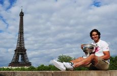 Rafael Nadal celebrates his seventh French Open title after beating Novak Djokovic in the men&#39;s singles final at Roland Garros in Paris.