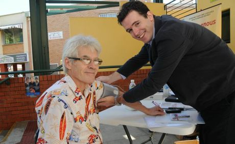 Tony Attard gets his blood pressure checked in Mary St by medical student Darcy Hinde.