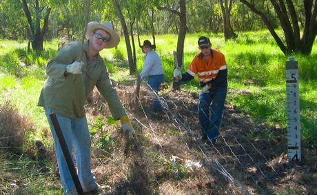 Southern Queensland Institute of TAFE Agriculture students work hard to repair flood-damaged properties.
