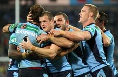 New South Wales Blues players celebrate their win over the Maroons in game 2 of the 2012 State of Origin series.