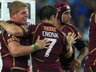 Maroons players celebrate after taking the lead against NSW Blues in State of Origin II.
