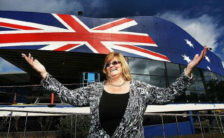 Goodna RSL general manager Deb Colbert outside the building which has been decorated with the Australian flag.