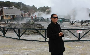 A guide at Whakarewarewa introduces visitors to the steaming cauldrons that naturally cook food at temperatures of up to 250 degrees.